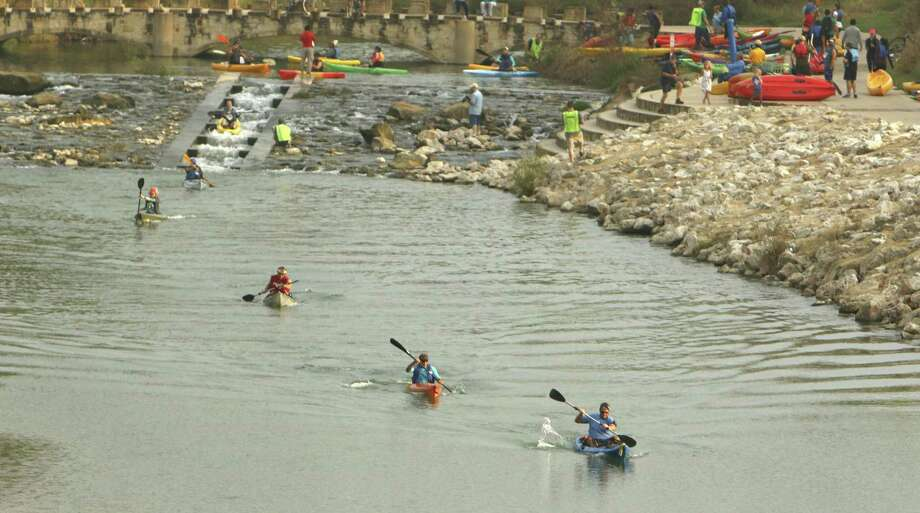 Kayakers near Concepción Park take part in the River Relay & Get Outdoors race and festival. The 4-kilometer race was accompanied by a 5-kilometer run. Photo: Photos By Ron Cortes /For The San Antonio Express-News / Freelance
