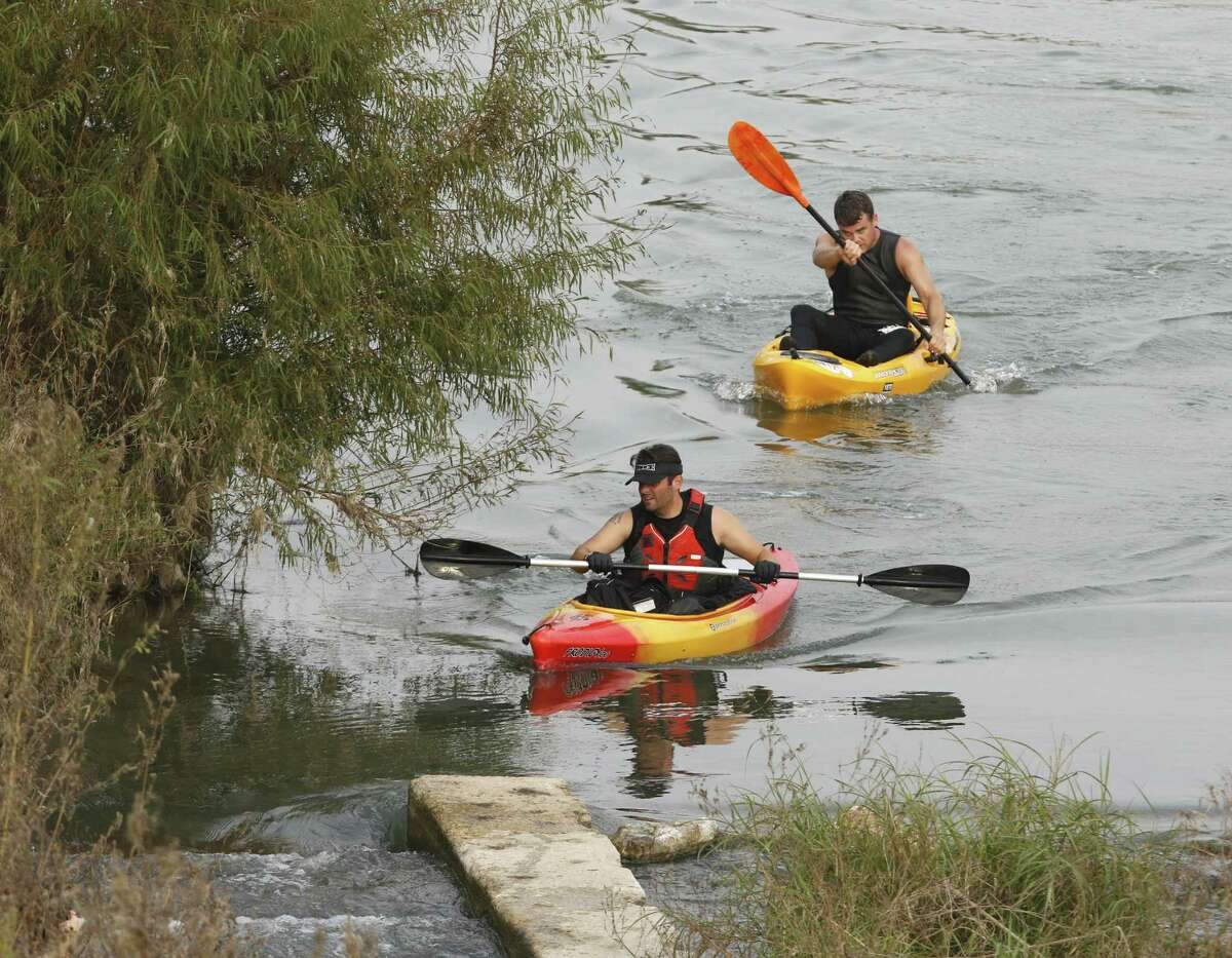 """Kayaker' maneuver as the get close to the finish line at Mission County Park as San Antonio River Foundation holds its River Relay -- a combined 5K run and 4K kayak race, in conjuction with the San Antonio River Authority's 8th annual """"Get Outdoors"""" event -- nature and fitness demonstrations, health screenings and other family friendly activites on Saturday, November 5, 2016."""