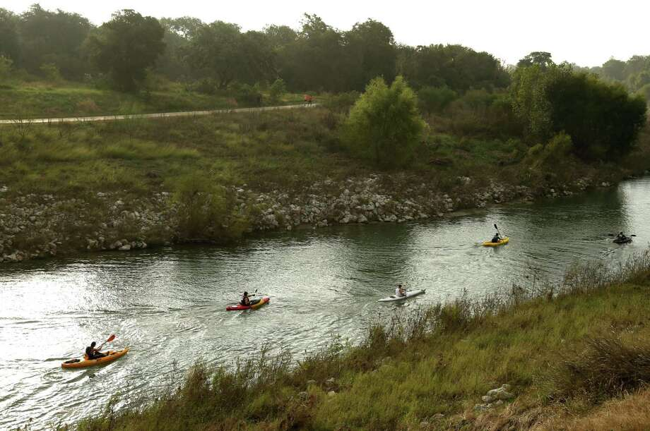 """Kayakers begin a race on the San Antonio River last year as part of the San Antonio River Authority's """"Get Outdoors"""" event. Photo: Ron Cortes /for The San Antonio Express-News / Freelance"""