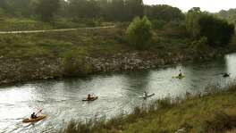 "Kayakers begin a race on the San Antonio River last year as part of the San Antonio River Authority's ""Get Outdoors"" event."