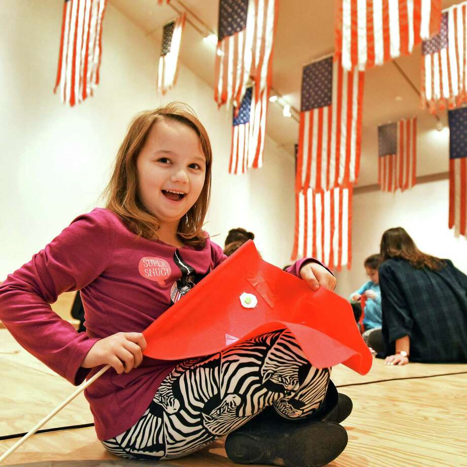 Seven-year-old Britta Putney of Jamestown makes a flag during the Tang's Family Saturday series beneath Mel Ziegler's More Perfect Union exhibit at the Tang Teaching Museum Nov. 5, 2016 in Saratoga Springs, NY.  (John Carl D'Annibale / Times Union) Photo: John Carl D'Annibale / 20038710A