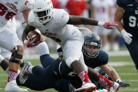 Florida Atlantic Owls running back Devin Singletary (5) gains yardage as Rice Owls linebacker Nick Uretsky (21) tries to take him down during the second quarter of a college football game at Rice Stadium, Saturday,Nov. 5, 2016 in Houston.