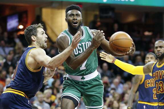 Boston Celtics' Jaylen Brown (7) goes up to shoot between Cleveland Cavaliers' Kevin Love and LeBron James (23) during the first half of an NBA basketball game Thursday, Nov. 3, 2016, in Cleveland. (AP Photo/Ron Schwane)