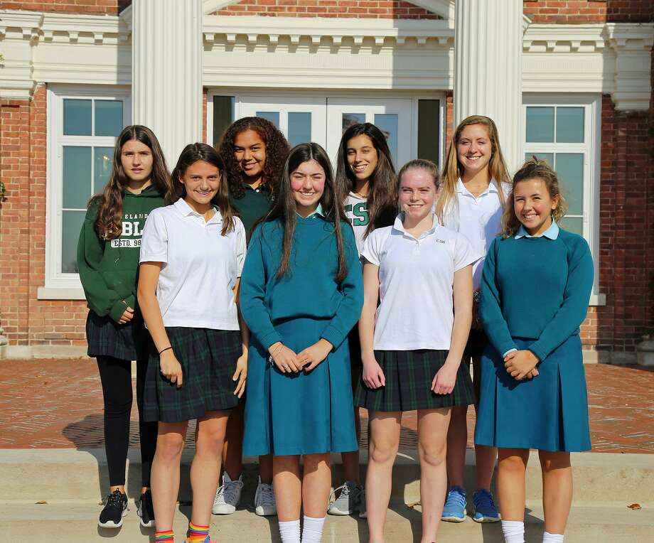 Sacred Heart international exchange students pose with their Sacred Heart Greenwich hosts. Front row, from L to R: Olivia Batal, Aisling Hoey, Mary Anne Gallagher and Bella O'Boyle. Back row, from L to R: Elena Pujol, Shantel Guzman, Maria Ribes and Katie Miller. Photo: Contributed