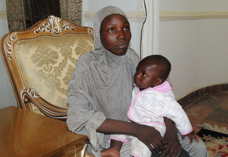 A recently rescued Nigerian Chibok girl with her child at a local Nigerian government council house in Maiduguri, Nigeria, Saturday, Nov. 5, 2016. Nigerian troops rescued one of the Chibok schoolgirls kidnapped by Boko Haram extremists more than two years ago in a pre-dawn raid Saturday on a forest hideout. She had a 10-month-old baby boy born to a Boko Haram fighter, said a statement from army spokesman Col. Sani Kukasheka Usman. (AP Photo/Jossy Ola) Photo: Jossy Ola, STR / Copyright 2016 The Associated Press. All rights reserved.