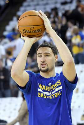 OAKLAND, CA - OCTOBER 25:  Klay Thompson #11 of the Golden State Warriors warms up priot to playing the San Antonio Spurs in an NBA basketball game at ORACLE Arena on October 25, 2016 in Oakland, California. NOTE TO USER: User expressly acknowledges and agrees that, by downloading and or using this photograph, User is consenting to the terms and conditions of the Getty Images License Agreement.  (Photo by Thearon W. Henderson/Getty Images)