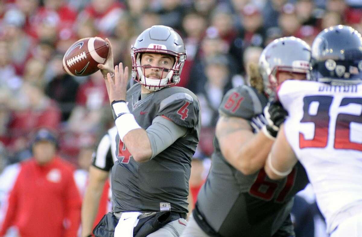 Washington State quarterback Luke Falk looks to pass during the first half.