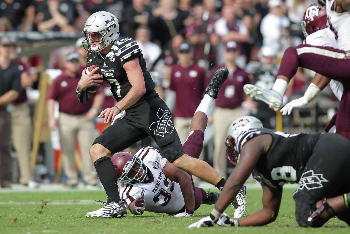 Mississippi State quarterback Nick Fitzgerald (7) rushes for a first down as Texas A&M defender Shaan Washington (33) attempts to make a shoe-string tackle during their NCAA football game at Davis Wade Stadium at Scott Field in Starkville, Miss., Saturday, Nov. 5, 2016. Mississippi State won 35-28. (James Pugh/The Laurel Chronicle, via AP)
