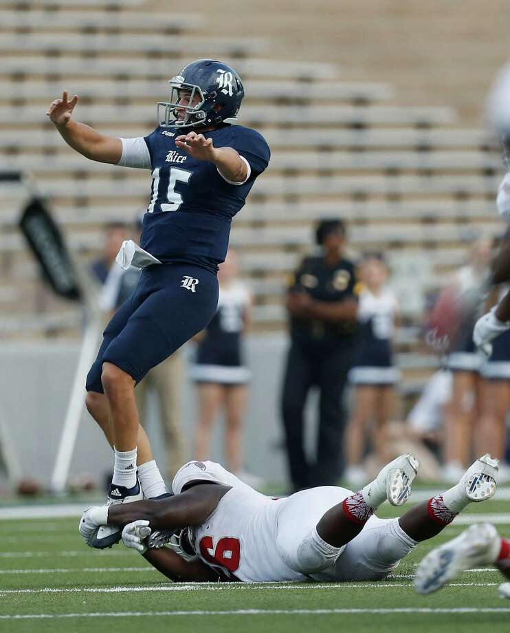 Rice Owls quarterback J.T. Granato (15) is toe tackled after passing the ball by Florida Atlantic Owls place kicker Patrick Trepcos (96) during the second half of a college football game at Rice Stadium, Saturday,Nov. 5, 2016 in Houston.  FAU won the game 42-25. Photo: Karen Warren, Houston Chronicle / 2016 Houston Chronicle