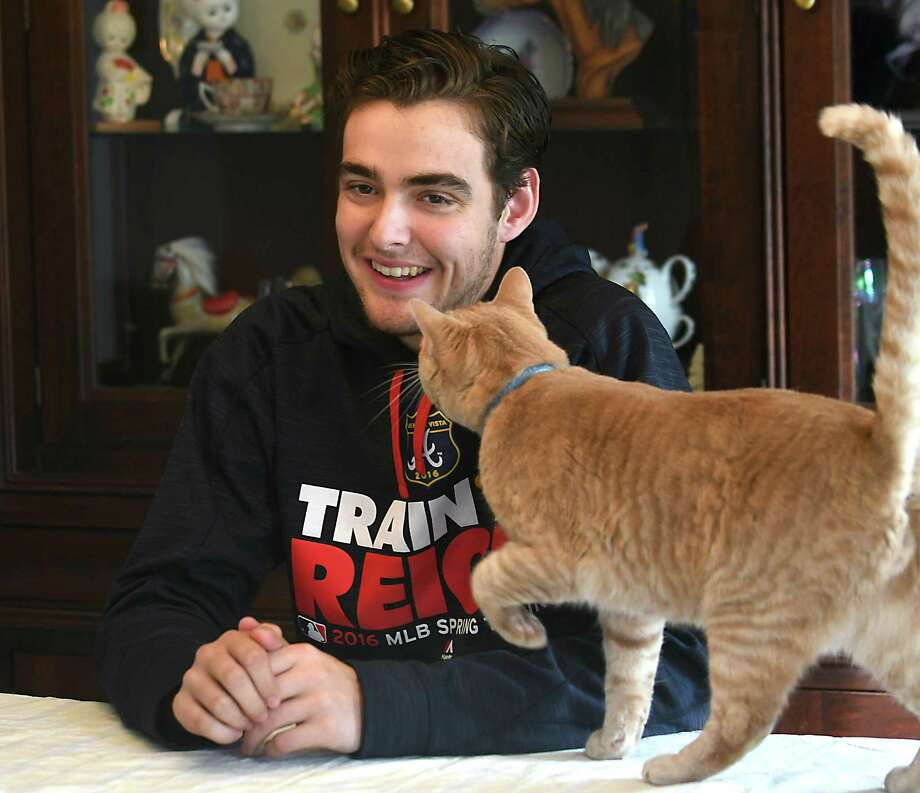 Ian Anderson's cat Charlie looks for attention as he is interviewed at his home on Tuesday, Nov. 1, 2016 in Rexford, N.Y. Anderson, who pitched for Shenendehowa, was the third overall pick in the MLB draft in June by the Atlanta Braves. (Lori Van Buren / Times Union) Photo: Lori Van Buren / 20038626A