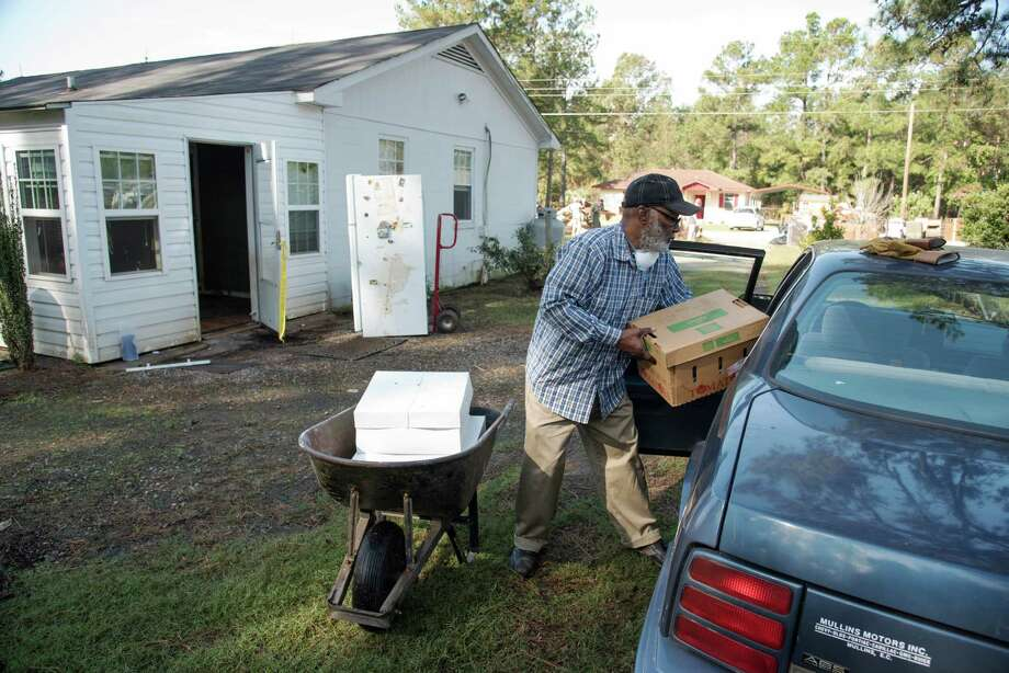 James Daniel Lee, 72, places boxes of personal items into his car after his home was heavily damaged by floodwaters caused by rain from Hurricane Matthew in Nichols, S.C., Thursday, Oct. 27, 2016. Nearly a month since floodwaters consumed the town, few have returned. The fear is that many never will. A stew of contaminants stood inches to feet deep in homes for a week. As it receded, toxic black mold grew rampant, leaving nearly all of the town's 261 homes uninhabitable. Few, if any, had flood insurance. (AP Photo/Mike Spencer) ORG XMIT: NCMS115 Photo: Mike Spencer / FR171472 AP