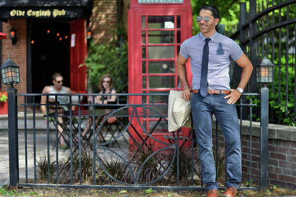 Matt Baumgartner outside his Olde English Pub on Broadway Friday May 29, 2015 in Albany, NY.  Matt is wearing Ray Ban aviator sunglasses, a Howes & Baum shirt with a Kenneth Cole tie, J Crew pants, a Zara belt, Alden shoes and a Rolex watch.  (John Carl D'Annibale / Times Union)