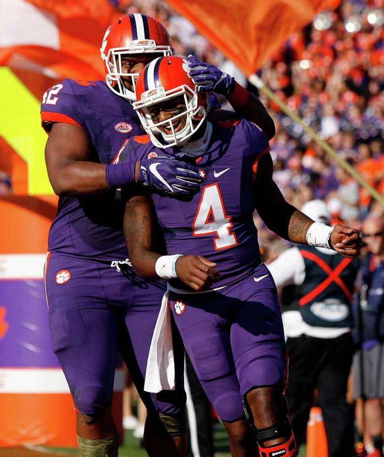 CLEMSON, SC - NOVEMBER 05: Deshaun Watson #4 of the Clemson Tigers reacts with Christian Wilkins #42 after scoring a touchdown during the game against the Syracuse Orange at Memorial Stadium on November 5, 2016 in Clemson, South Carolina.  (Photo by Tyler Smith/Getty Images) ORG XMIT: 678468481 Photo: Tyler Smith / 2016 Getty Images