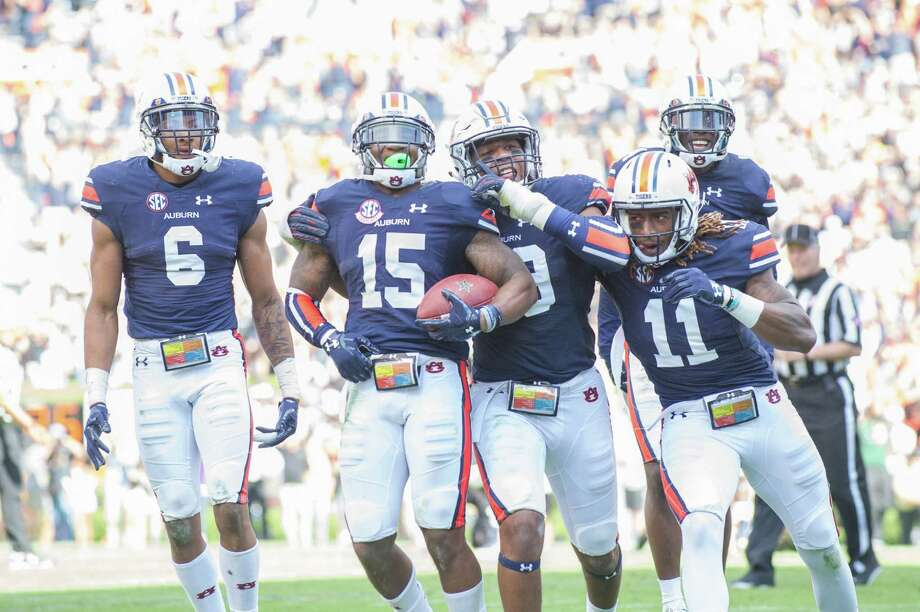 Auburn defensive back Josh Holsey cradles a prized possession after sealing the comeback victory with an interception in the closing seconds against Vanderbilt. Photo: Michael Chang, Stringer / 2016 Getty Images