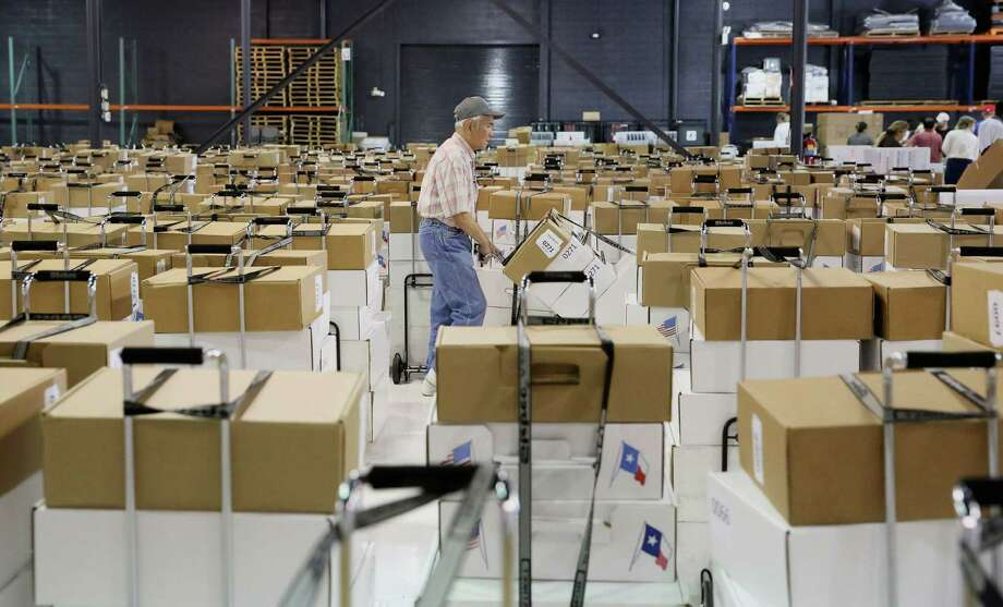 Harris County Clerk Duoc Tian moves election equipment and supplies destined for 764 polling sites. More than 6,000 poll workers will be in place Tuesday. Photo: Yi-Chin Lee, Staff / © 2016  Houston Chronicle