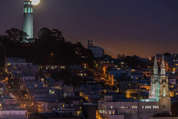 Full moon rising over Coit Tower in San Francisco, CA