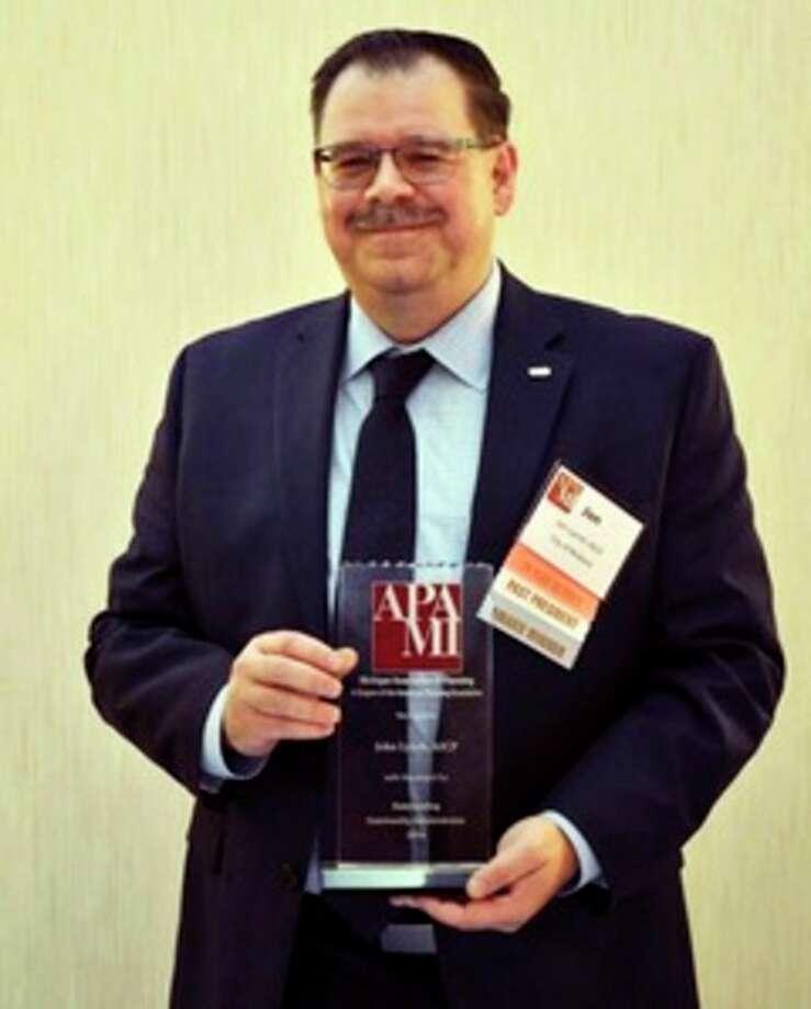 Jon Lynch with his award. Photo provided