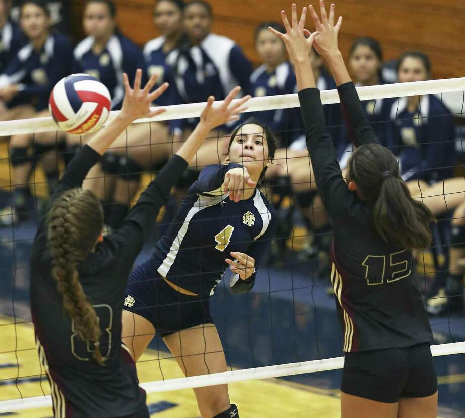 Angelina Martinez jams a ball through the Lion defense as Holy Cross beats San Antonio Christian 3-0 on Nov. 5. Photo: Tom Reel /San Antonio Express-News / 2016 SAN ANTONIO EXPRESS-NEWS