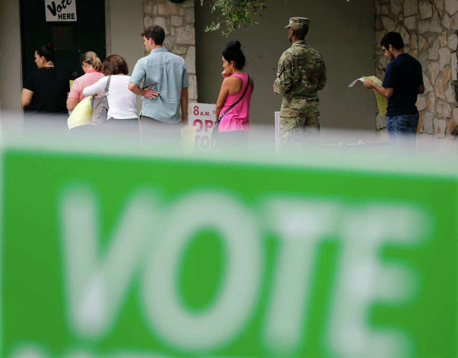 In this Nov. 4, 2016, photo, voters wait in line to cast ballots at an early polling site in San Antonio. Your parents were right: Math really does matter. After all of the tumult and tedium of a long, ugly presidential campaign, Election Day is all about which candidate can win enough states to get to 270 electoral votes.(AP Photo/Eric Gay) Photo: Eric Gay, STF / Copyright 2016 The Associated Press. All rights reserved.