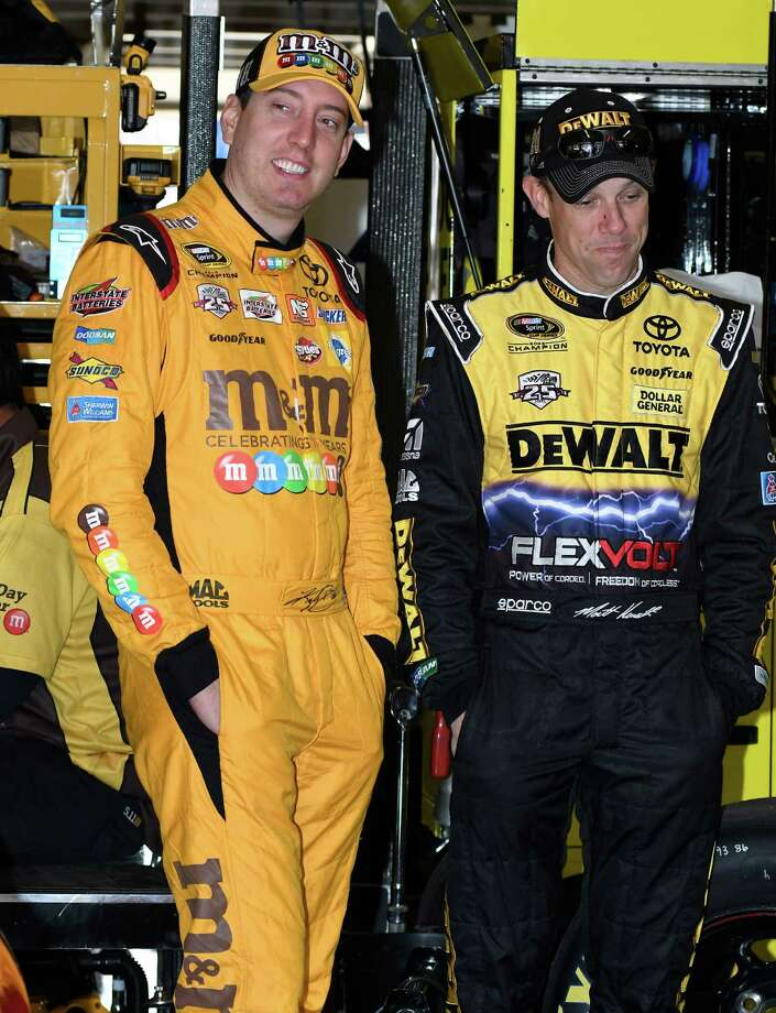 Joe Gibbs Racing teammates Kyle Busch, left, and Matt Kenseth stand in the garage together before NASCR Sprint Cup Series auto racing practice at Texas Motor Speedway Saturday, Nov. 5, 2016, in Fort Worth, Texas. (AP Photo/Larry Papke) ORG XMIT: TMS105 Photo: Larry Papke / FR58581 AP