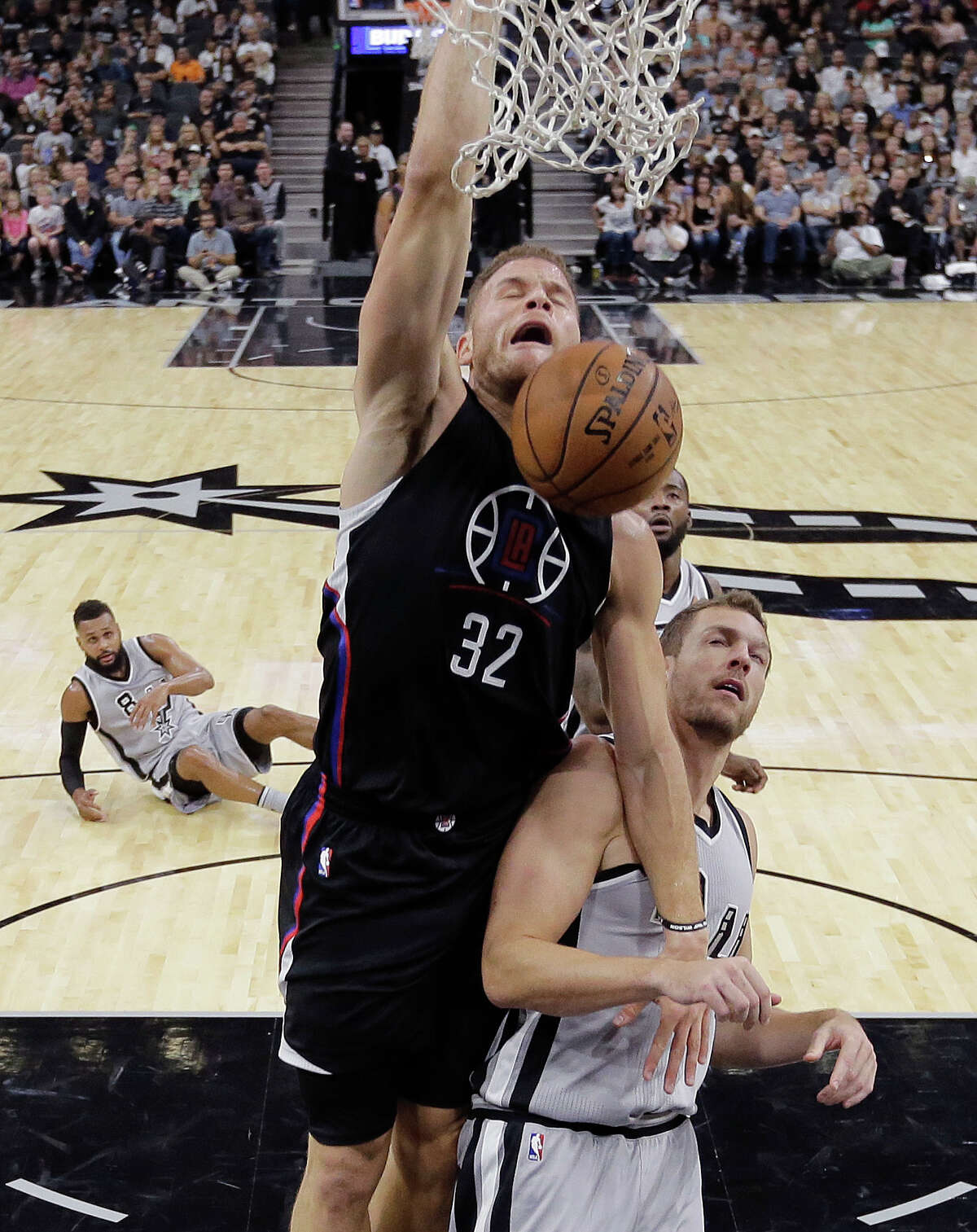 Los Angeles Clippers forward Blake Griffin (32) scores over San Antonio Spurs forward David Lee (10) during the first half of an NBA basketball game, Saturday, Nov. 5, 2016, in San Antonio. (AP Photo/Eric Gay)