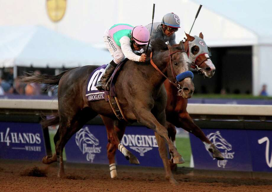 Arrogate, with jockey Mike Smith in saddle, passes California Chrome and Victor Espinoza to win the $6 million Breeders' Cup Classic on Saturday. Photo: Luis Sinco, MBR / Los Angeles Times