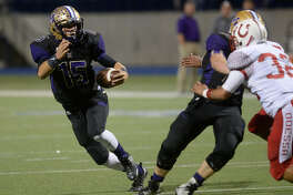 Midland High quarterback Jackson Anuszkiewicz runs the ball against Odessa High's on Friday, Nov. 4, 2016, at Grande Communications Stadium. James Durbin/Reporter-Telegram.
