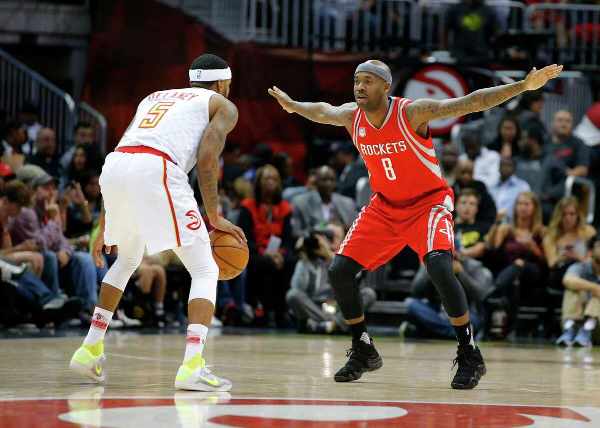 Atlanta Hawks guard Malcolm Delaney (5) is defended by Houston Rockets guard Bobby Brown (8) during the second half of an NBA basketball game on Saturday, Nov. 5, 2016, in Atlanta. The Hawks won 112-97. (AP Photo/Todd Kirkland)