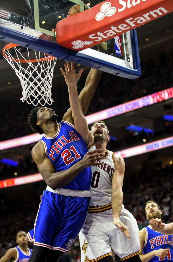 Philadelphia 76ers' Joel Embiid, left, blocks the shot and collides with Cleveland Cavaliers' Kevin Love, right, during the first half of an NBA basketball game, Saturday, Nov. 5, 2016, in Philadelphia. (AP Photo/Chris Szagola) ORG XMIT: PACS103 Photo: Chris Szagola / FR170982 AP