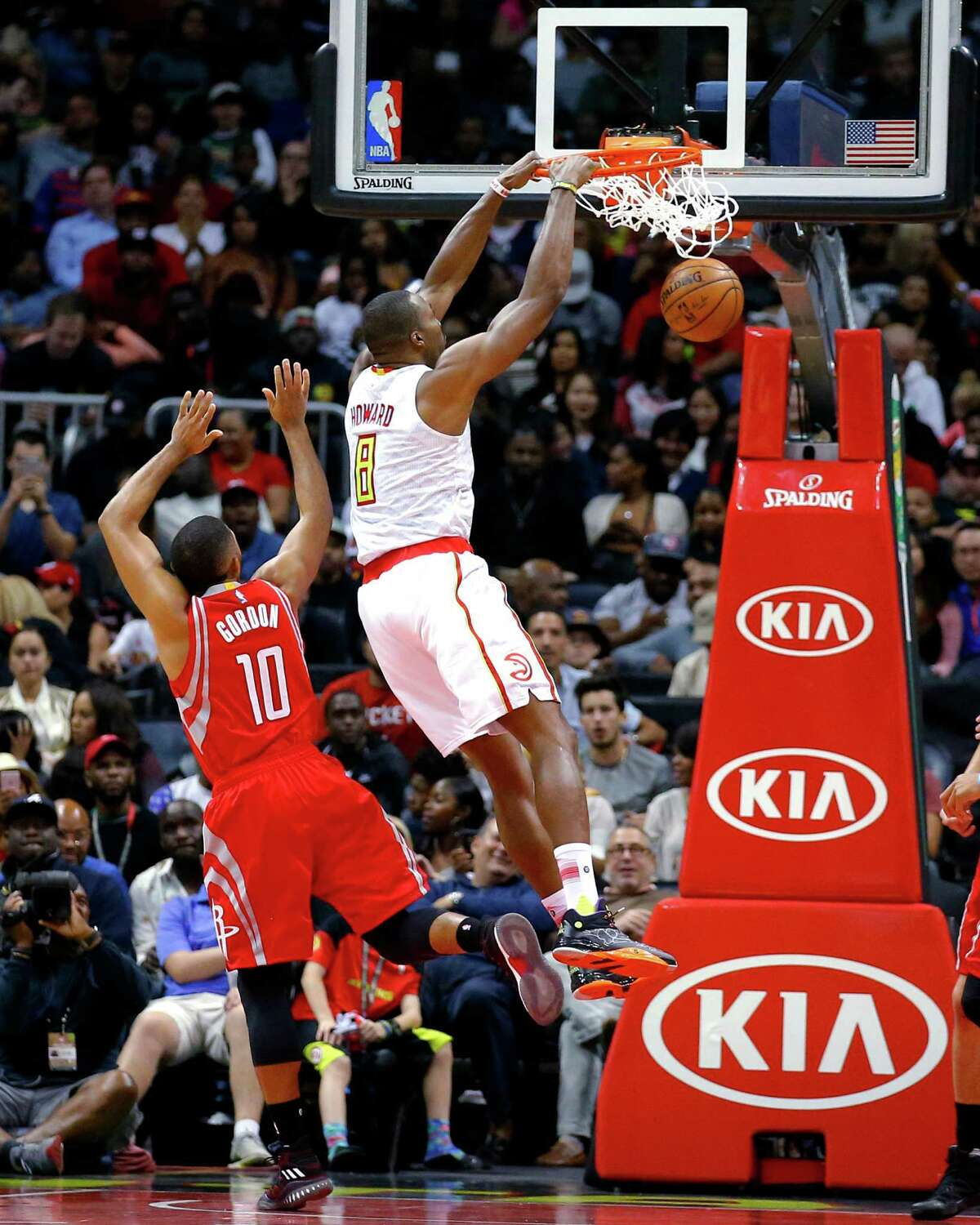 Atlanta Hawks center Dwight Howard (8) dunks in front of Houston Rockets guard Eric Gordon (10) during the second half of an NBA basketball game Saturday, Nov. 5, 2016, in Atlanta. The Hawks won 112-97. (AP Photo/Todd Kirkland)