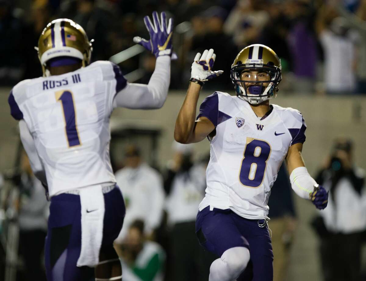 Washington Huskies wide receiver John Ross (1) celebrates with wide receiver Dante Pettis (8) after a touchdown against the California Golden Bears during the first quarter at Memorial Stadium, Saturday, Nov. 5, 2016.