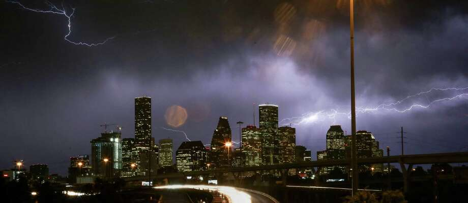 Lightning flashes over the Houston skyline. (Jon Shapley / Houston Chronicle ) Photo: Jon Shapley, Staff / © 2015  Houston Chronicle