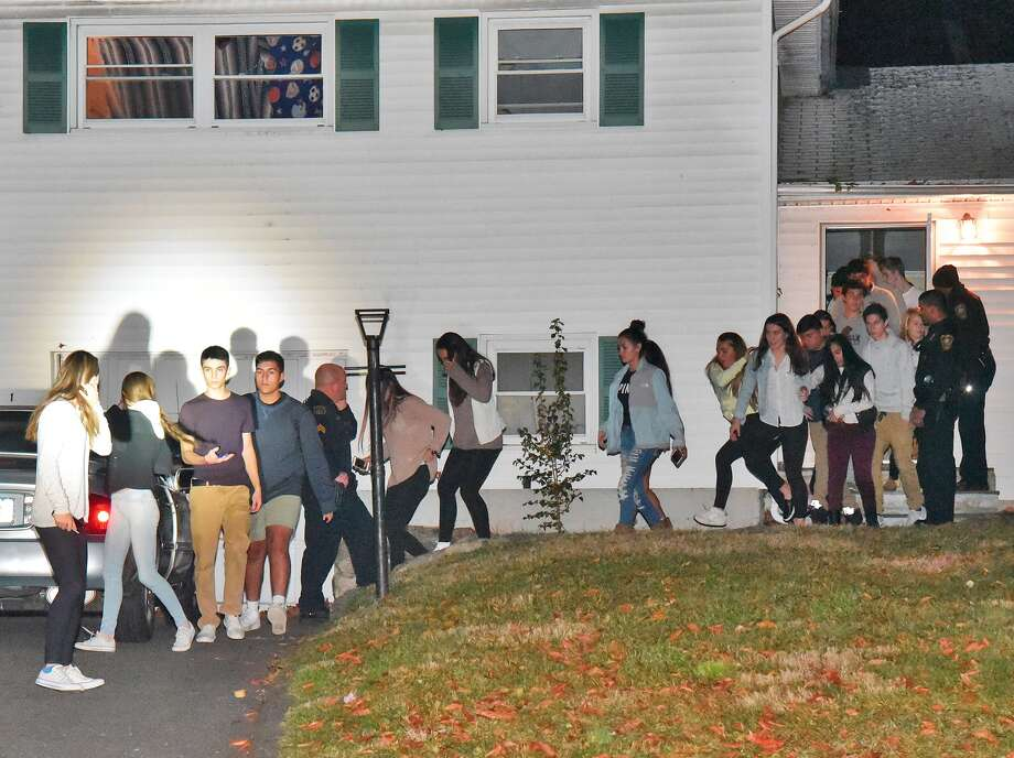 When officers entered the Wakerobin Road house, they reported finding dozens of teenagers there. They streamed out the front door when the officers announced the party was over and meandered in the street. Photo: Harold F. Cobin