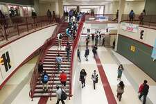 Students head to classrooms at Judson High School, Monday, April 13, 2015. Bexar County's public school attrition rates have remained stubbornly high over the past several years, according to an annual report released by the Intercultural Development Research Association. At 28 percent, San Antonio leads other metropolitan areas in Texas with its attrition rate, which measures how many students leave school during a certain time period. Factors that exacerbate dropout rates include zero tolerance policies, weak curriculums, poor funding and an emphasis on high-stakes testing.