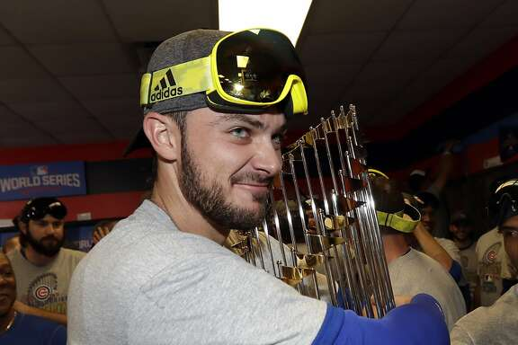 Chicago Cubs' Kris Bryant celebrates with his teammates after Game 7 of the Major League Baseball World Series against the Cleveland Indians Thursday, Nov. 3, 2016, in Cleveland. The Cubs won 8-7 in 10 innings to win the series 4-3. (AP Photo/David J. Phillip)