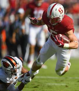 PALO ALTO, CA - NOVEMBER 05:  Christian McCaffrey #5 of the Stanford Cardinal gets tackled by Xavier Crawford #22 of the Oregon State Beavers during the second quarter of their NCAA football game at Stanford Stadium on November 5, 2016 in Palo Alto, California.  (Photo by Thearon W. Henderson/Getty Images)