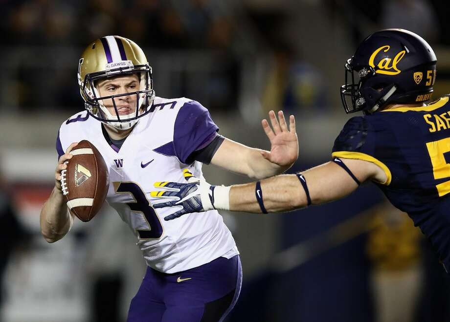 BERKELEY, CA - NOVEMBER 05:  Jake Browning #3 of the Washington Huskies is pressured by Cameron Saffle #51 of the California Golden Bears at California Memorial Stadium on November 5, 2016 in Berkeley, California.  (Photo by Ezra Shaw/Getty Images) Photo: Ezra Shaw, Getty Images
