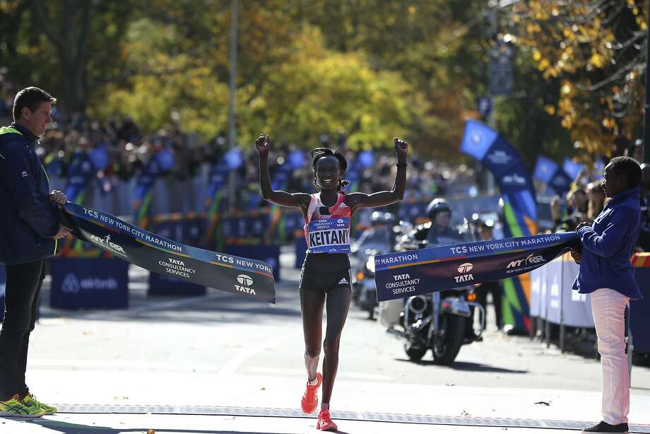 Mary Keitany, of Kenya, crosses the finish line first in the women's division of the 2016 New York City Marathon in New York, Sunday, Nov. 6, 2016. (AP Photo/Seth Wenig) Photo: Seth Wenig, Associated Press