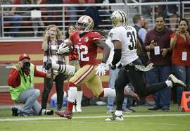 San Francisco 49ers running back DuJuan Harris runs with the ball for a 47-yard touchdown past New Orleans Saints free safety Jairus Byrd, right, during the first half of an NFL football game Sunday, Nov. 6, 2016, in Santa Clara, Calif. (AP Photo/Tony Avelar)