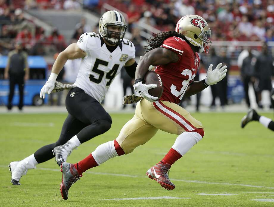San Francisco 49ers running back DuJuan Harris runs with the ball past New Orleans Saints inside linebacker Nate Stupar (54) during the first half of an NFL football game, Sunday, Nov. 6, 2016, in Santa Clara, Calif. (AP Photo/Tony Avelar) Photo: Tony Avelar, Associated Press