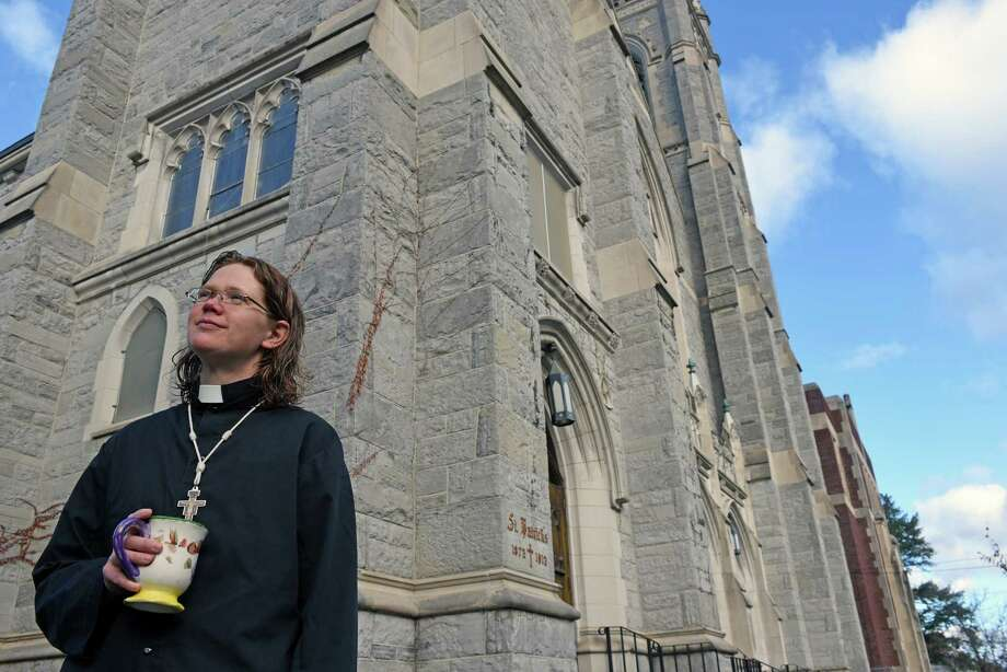 Rev. Christina Hunter at the former St. Patrick's Roman Catholic Church now owned by the Albany Episcopal Diocese on Friday Nov. 4, 2016 in Troy, N.Y.  It was bought for $1. It's in North Central the city's poorest neighborhood. Rev. Christina Hunter, her husband, also an Episcopal ministers and their baby have move into the old rectory, hold services there. She's been in North Central since 2011.(Michael P. Farrell/Times Union) Photo: Michael P. Farrell / 20038690A
