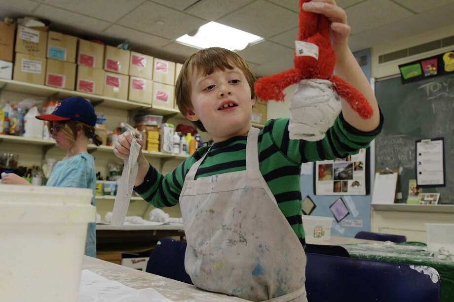 Brendan Bergin, 6, of Albany wraps his Elmo doll in strips of plaster cloth as he mummifies   Elmo at the Mummy Birthday Party at the Albany Institute of History & Art on Sunday, Nov. 6, 2016, in Albany, N.Y.  The event marks the 107th anniversary of the two mummies arrival at the museum.  Starting on Friday, Nov. 11th and running through Sunday, the museum will hold their annual Lego Building Challenge.  Pre-registration is suggested for that event.  (Paul Buckowski / Times Union) Photo: PAUL BUCKOWSKI / 20038702A