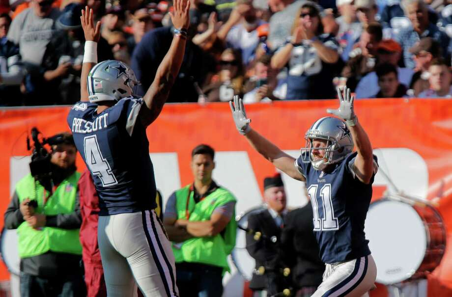 Cowboys receiver Cole Beasley (11) celebrates with quarterback Dak Prescott (4) after they hooked up on a 6-yard touchdown pass in the second quarter. Photo: Rodger Mallison, MBR / Fort Worth Star-Telegram