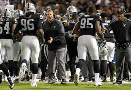 Oakland Raiders' head coach Jack Del Rio congratulates the defense after a1st quarter stop of a Denver Broncos' drive during NFL game at Oakland Coliseum in Oakland, Calif., on Sunday, November 6, 2016.