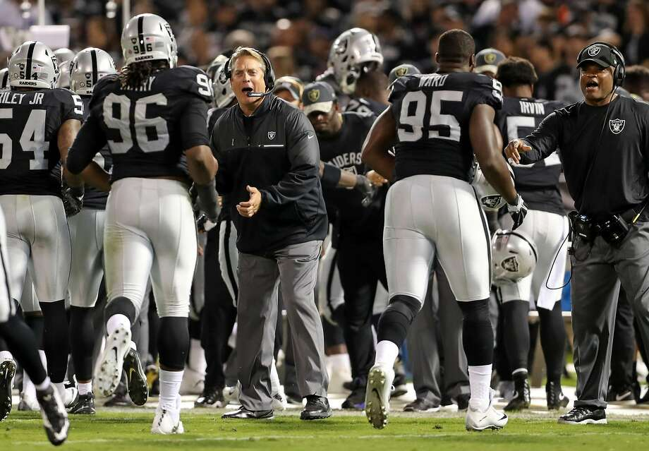 Oakland Raiders' head coach Jack Del Rio congratulates the defense after a1st quarter stop of a Denver Broncos' drive during NFL game at Oakland Coliseum in Oakland, Calif., on Sunday, November 6, 2016. Photo: Scott Strazzante, The Chronicle