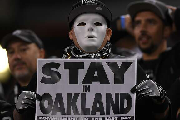 OAKLAND, CA - NOVEMBER 06:   Oakland Raiders fans display signs in support of the team staying in Oakland during their game against the Denver Broncos at Oakland-Alameda County Coliseum on November 6, 2016 in Oakland, California. (Photo by Thearon W. Henderson/Getty Images)