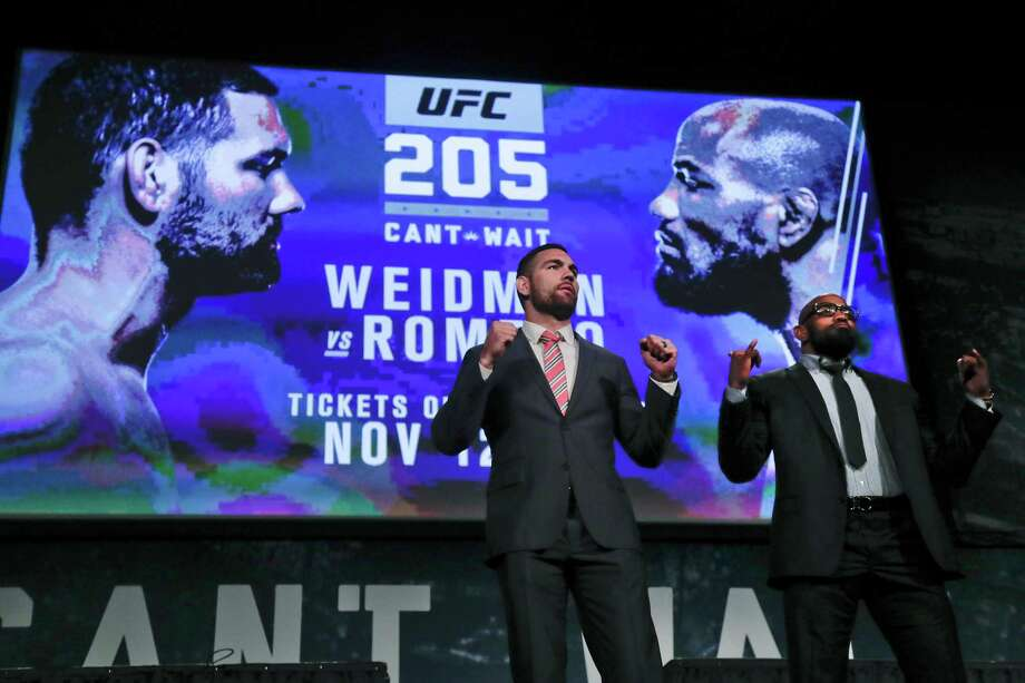 "FILE- In this Sept. 27, 2016 file photo, UFC middleweight fighters Chris Weidman, left, and Yoel Romero pose for photos during a news conference for UFC 205 in New York. Weidman and Romero are on the first major UFC card to be held in New York after the state legislature legalized the sport earlier in 2016. ""This is a dream come true,"" says middleweight Chris Weidman, a native New Yorker, who will be part of the undercard for the Saturday, Nov 12, 2016, pay-per-view event that features a lightweight title bout between Conor McGregor and Eddie Alvarez. (AP Photo/Julie Jacobson, File) ORG XMIT: NYR401 Photo: Julie Jacobson / Copyright 2016 The Associated Press. All rights reserved."