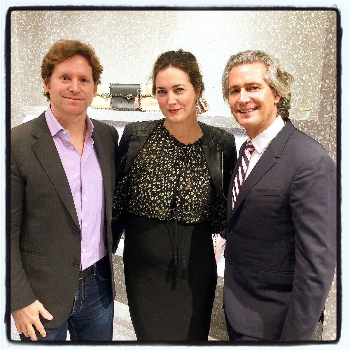 Trevor and Alexis Traina (left) with Valentino global ambassador Carlos Souza at the boutique for Fulk's book signing. Oct 2016.