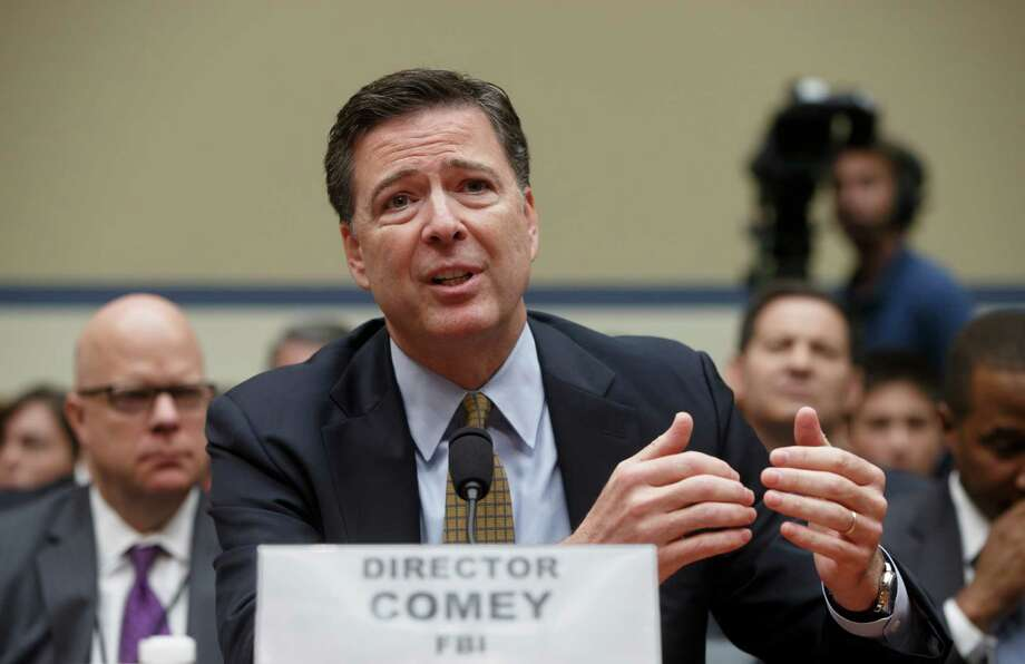 FILE - In this July 7, 2016 file photo, FBI Director James Comey testifies on Capitol Hill in Washington before the House Oversight Committee to explain his agency's recommendation to not prosecute Hillary Clinton. In a letter from Comey released on Nov. 6, he tells Congress review of additional Clinton emails does not change conclusion she should not face charges. (AP Photo/J. Scott Applewhite, File) ORG XMIT: WX110 Photo: J. Scott Applewhite / AP