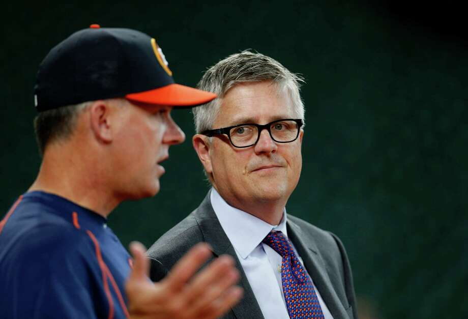 Astros general manager Jeff Luhnow, right, is tasked with rebuilding a club that underachieved in 2016. Photo: Karen Warren, Staff / © 2016 Houston Chronicle